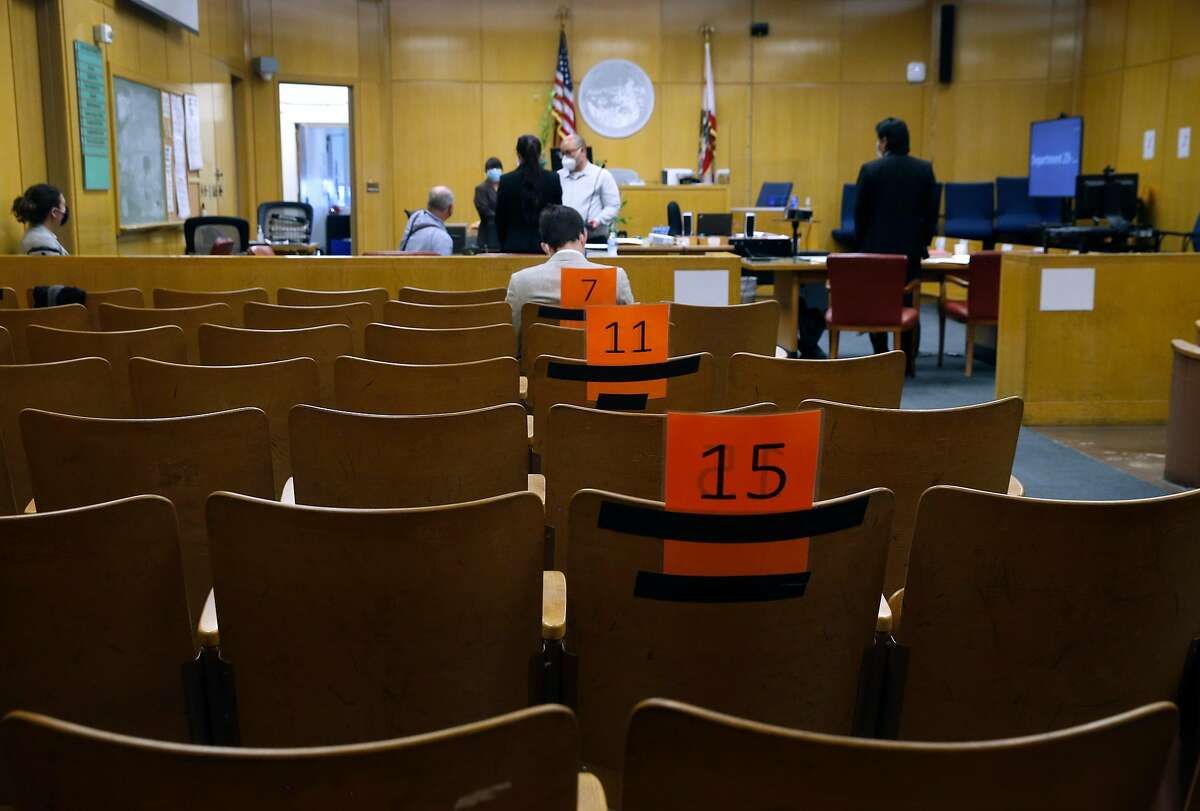 Seats are assigned and arranged to maintain social distancing in a courtroom at the Hall of Justice in San Francisco, Calif. on Thursday, July 16, 2020 before jury selection begins next week for the first criminal case to be tried during coronavirus pandemic.