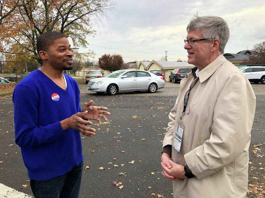 Stratford Democratic Town Council Member David Harden, left, talking with District 8 Democratic nominee James Simon outside Chapel Street School on Election Day, Nov. 5, 2019. Photo: Ethan Fry / Hearst Connecticut Media