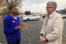 Stratford Democratic Town Council Member David Harden, left, talking with District 8 Democratic nominee James Simon outside Chapel Street School on Election Day, Nov. 5, 2019.