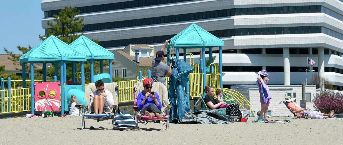 Beach goers spend a day at West Beach in Stamford, Connecticut on May 2, 2020.