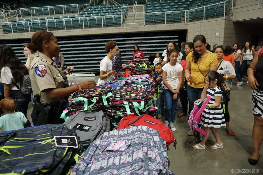 Compassion Katy is preparing to host its drive-thru Operation Back 2 School event that should provide backpacks and school supplies to around 3,000 Katy Independent School District elementary students at 18 Title I schools. Here, students pick out their backpacks at the 2019 event. Photo: Courtesy Of Compassion Katy