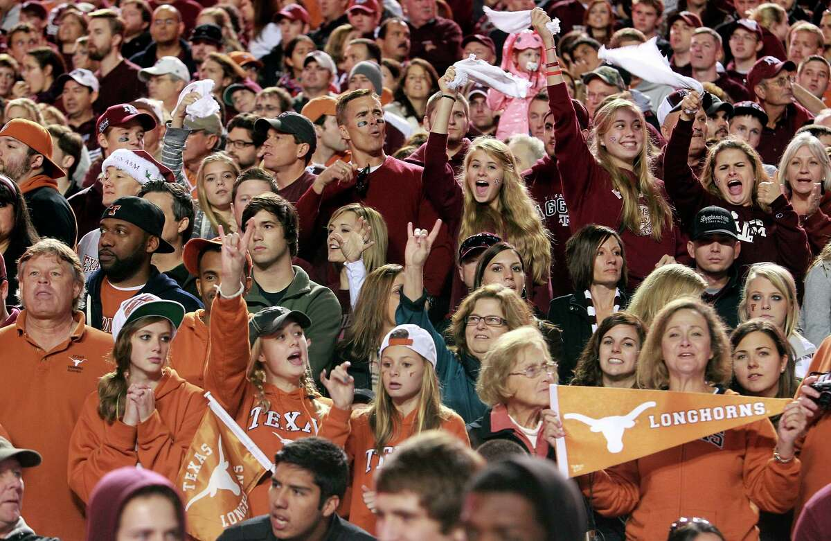 SPORTS Aggies and Longhorns cheer together as Texas A&M hosts UT at Kyle Field in College Station on November 24, 2011. Tom Reel/Staff