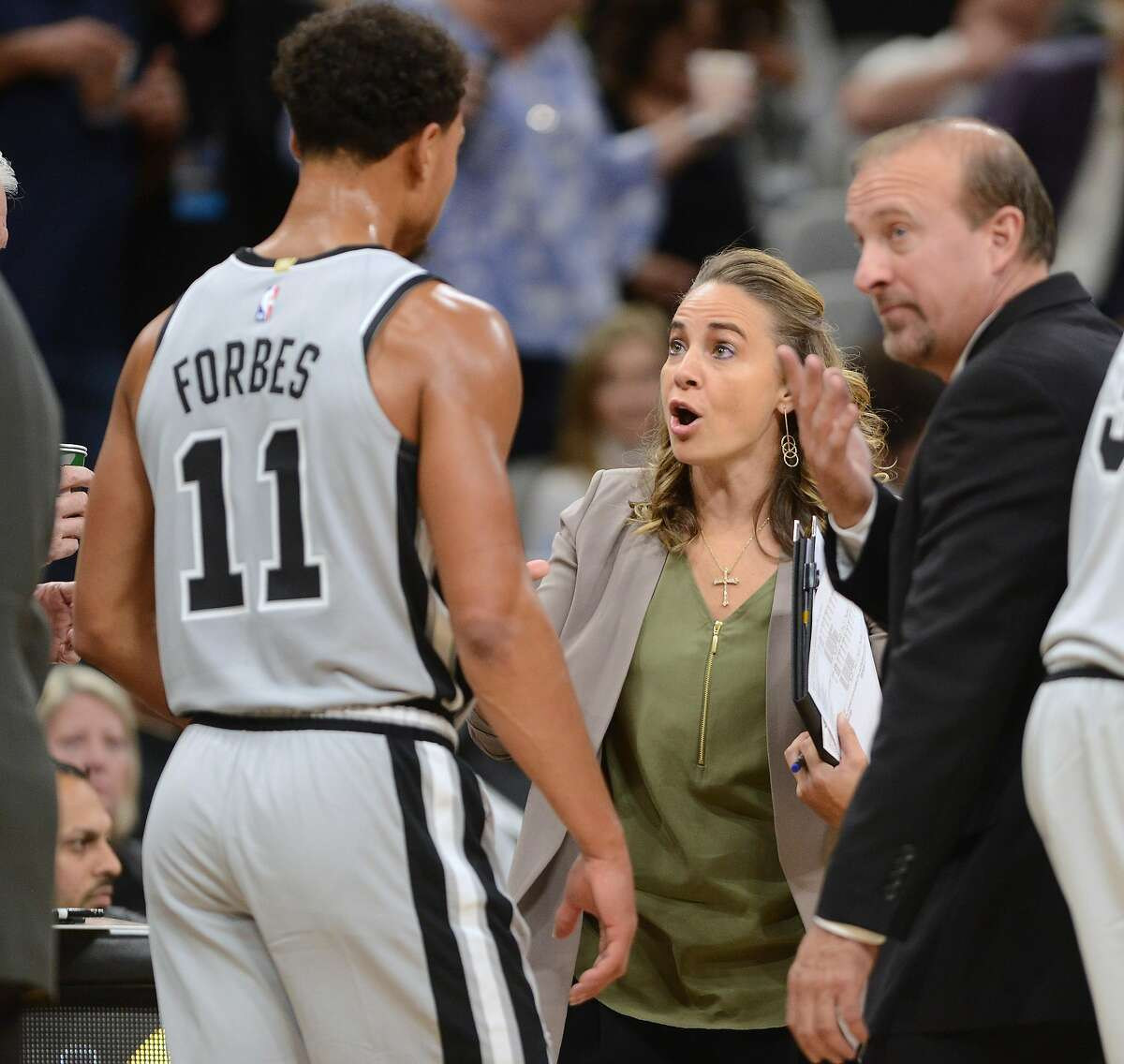 San Antonio Spurs assistant coach Becky Hammon speaks with Bryn Forges (11) during first-half NBA action at the AT&T Center on Saturday, Oct. 27, 2018.