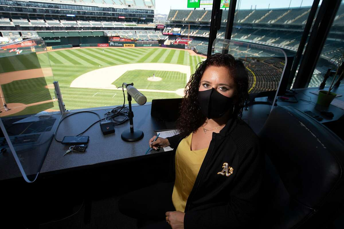 Oakland Athletics public address announcer Amelia Schimmel poses for a photograph in the announcer�s booth at the Coliseum before the start of the regular season Thursday, July 23, 2020 in Oakland, Calif. Schimmel is filling in for long-time A�s PA man Dick Calahan during the coronavirus pandemic.