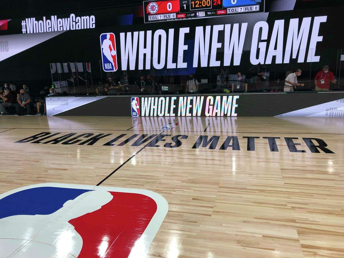 A basketball court is shown at the ESPN Wide World of Sports complex in Kissimmee, Fla., Tuesday, July 21, 2020. The NBA's marketing motto for the restart of the season at Walt Disney World is a€œWhole New Game,a€ and in many respects, thata€™s very true. (AP Photo/Tim Reynolds)