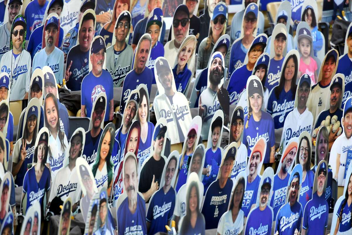 Cardboard cutouts of Los Angeles Dodgers fans are seen in seats before the game between the San Francisco Giants and the Los Angeles Dodgers at Dodger Stadium on July 23, 2020 in Los Angeles, California. (Photo by Harry How/Getty Images)