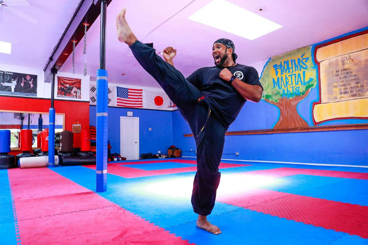 Chief instructor Joshua May teaches a martial arts class to students over Zoom at Frohm's Martial Arts in Oakland.