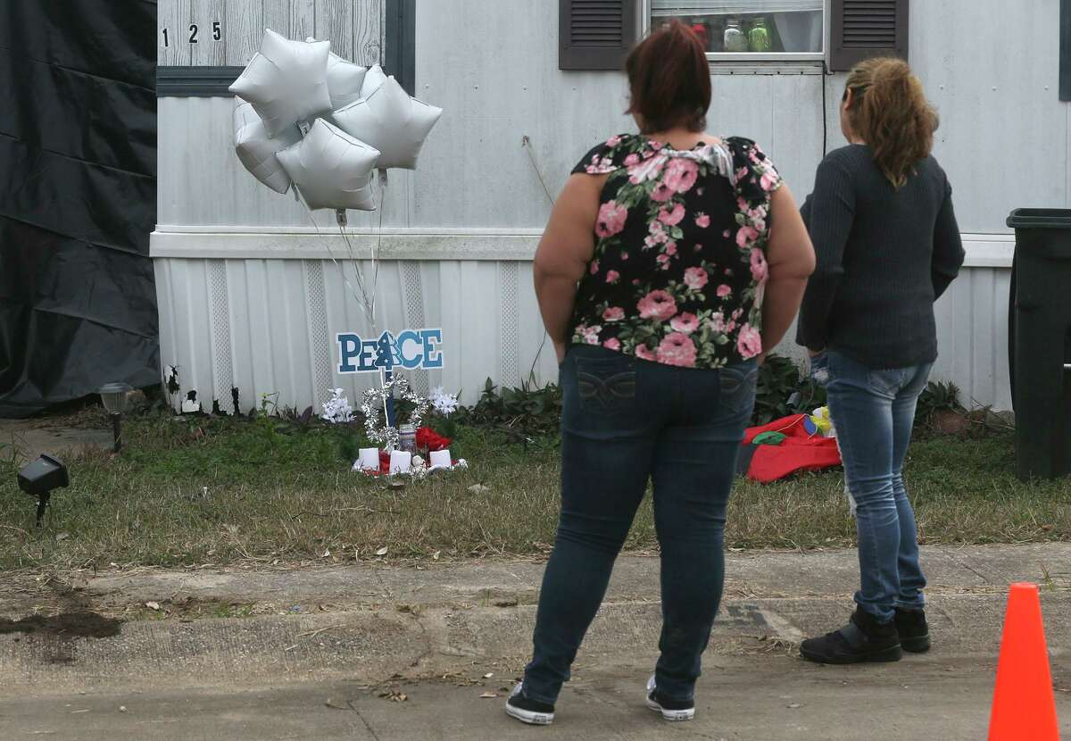 Cecilia Mora, left, and Blanca Martinez pause outside the home in the Pecan Grove community of Schertz, where 6-year-old Kameron Prescott was shot and killed by Bexar County Sheriff's deputies on Dec. 22, 2017. Prescott was shot while inside his home as four deputies were pursuing a suspect wanted for nonviolent crimes. Martinez said she placed the six balloons there because Kameron was 6.