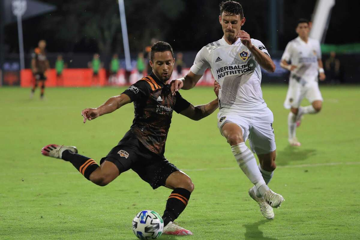 REUNION, FLORIDA - JULY 23: Niko Hansen #12 of Houston Dynamo and Daniel Steres #5 of Los Angeles Galaxy fight for the ball during a match between Los Angeles Galaxy and Houston Dynamo as part of group F of MLS Is Back Tournament at ESPN Wide World of Sports Complex on July 23, 2020 in Reunion, Florida.
