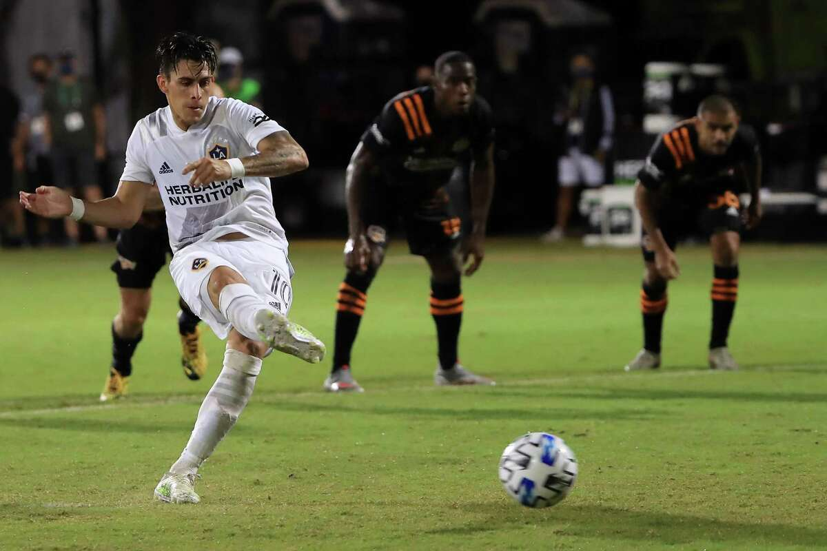 REUNION, FLORIDA - JULY 23: Cristian Pavon #10 of Los Angeles Galaxy makes a penalty kick to score the first goal of his team during a match against Houston Dynamo as part of group F of MLS Is Back Tournament at ESPN Wide World of Sports Complex on July 23, 2020 in Reunion, Florida.