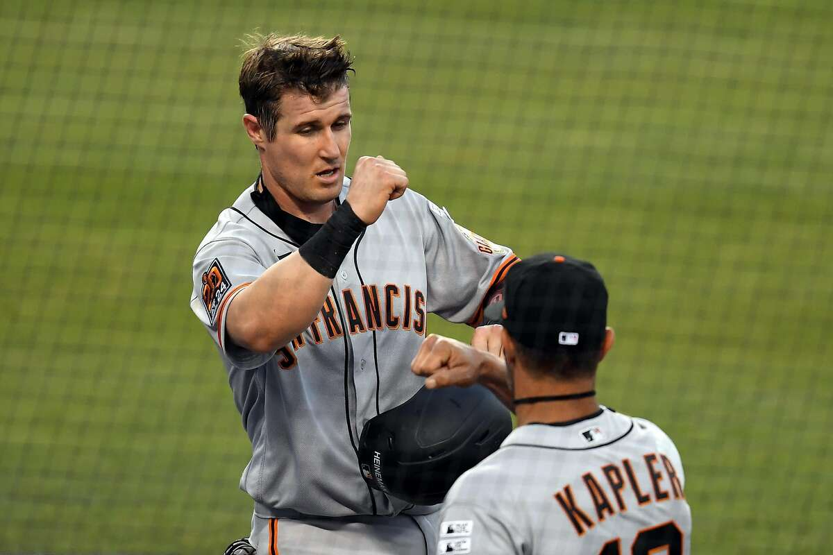Tyler Heineman #43 of the San Francisco Giants celebrates with manager Gabe Kapler at the dugout after scoring a run during the third inning against the Los Angeles Dodgers in the game at Dodger Stadium on July 23, 2020 in Los Angeles, California. (Photo by Harry How/Getty Images)