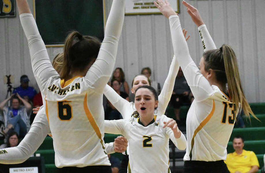 The Metro-East Lutheran girls volleyball team celebrates after winning a point during a match last season.