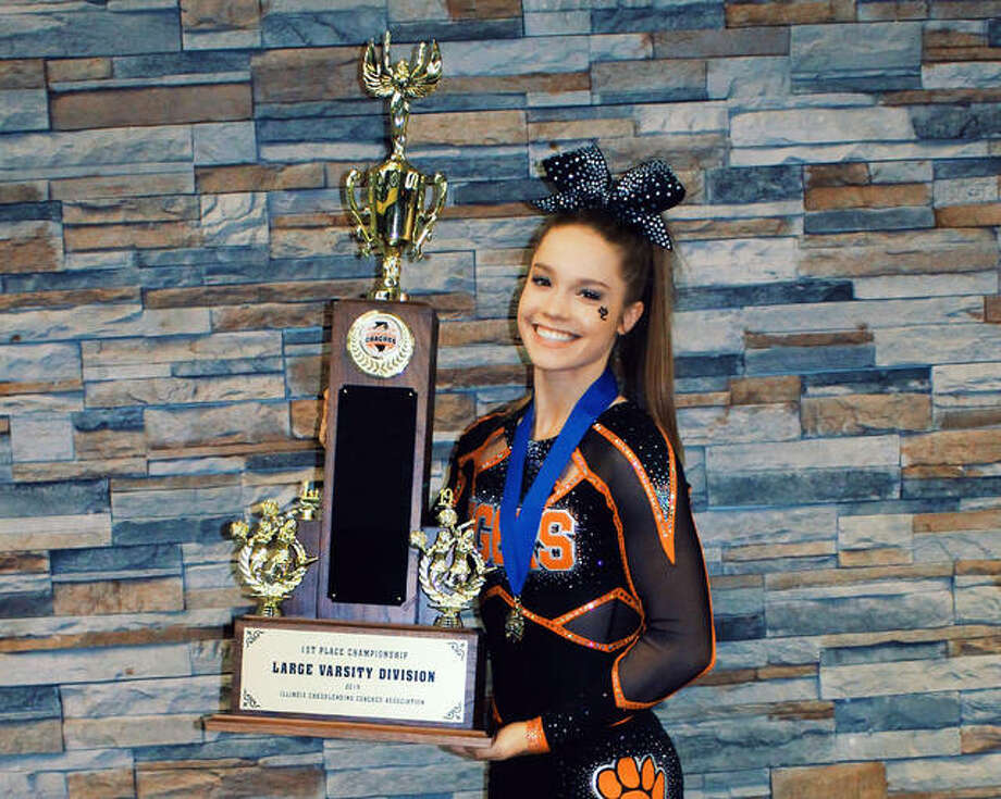 Edwardsville cheerleader Cyrina Beckmann with the trophy that EHS won for taking first place in the ICCA state competition in 2019. Photo: For The Intelligencer