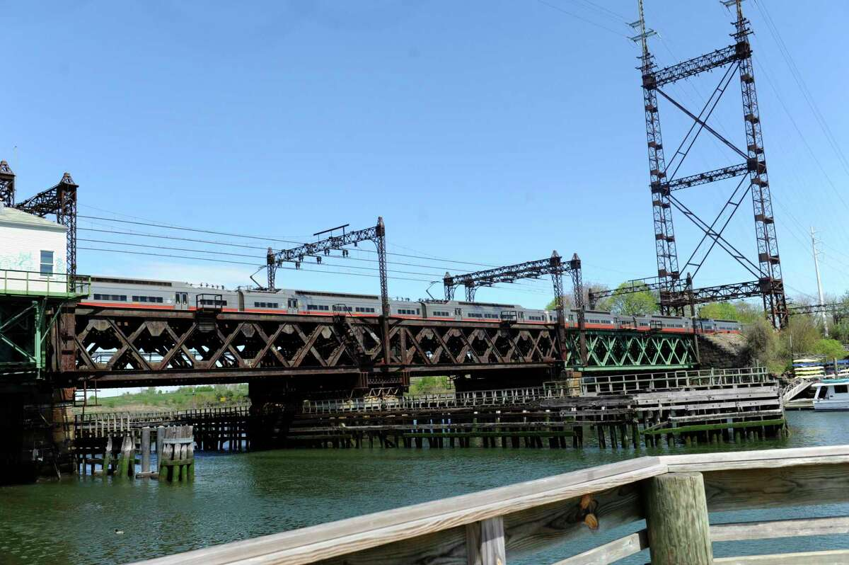A Metro-North Railroad train travels south on Walk bridge in South Norwalk An opening of the bridge is scheduled for 9:30 a.m. on Friday, July 24, 2020.