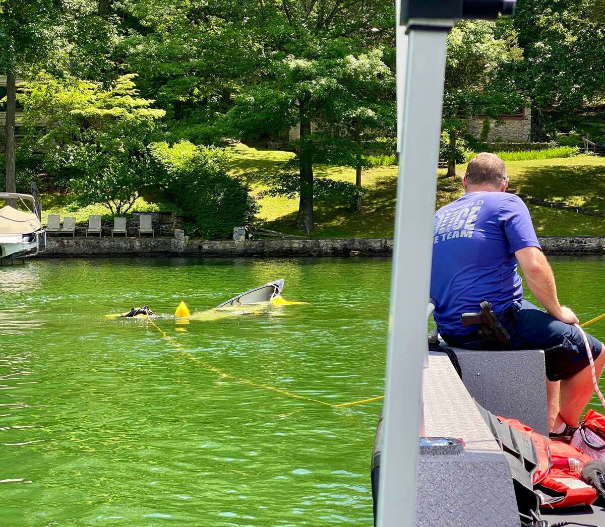 Brookfield first responders recover a sunken boat from Candlewood Lake the morning of Monday, July 20, 2020.