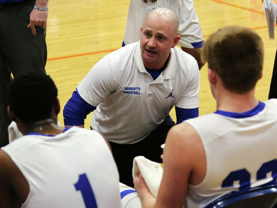 Marquette Catholic coach Steve Medford talks to his players on the bench during a timeout at the Okawville Tournament last season. Medford is 2020 Telegraph Small-Schools Boys Basketball Coach of the Year. Photo: Greg Shashack / The Telegraph