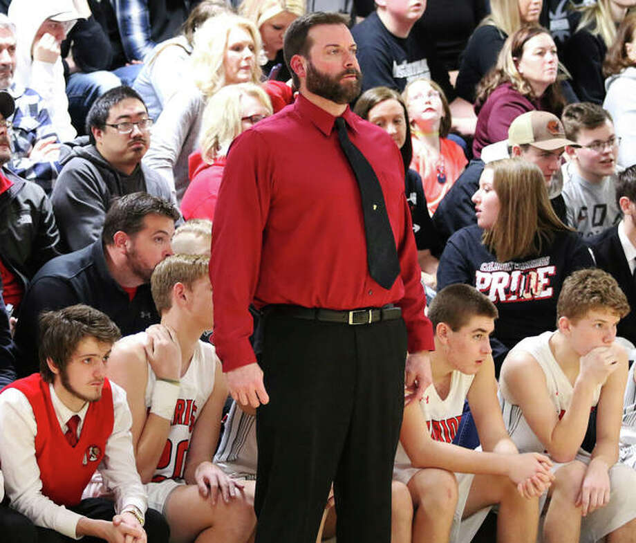 Calhoun coach Ryan Graner, watching his team compete during the Winchester Tournament, is 2020 Telegraph Small-Schools Boys Basketball Coach of the Year after leading the Warriors to a 25-8 record and a Class 1A regional title. Photo: Greg Shashack / The Telegraph