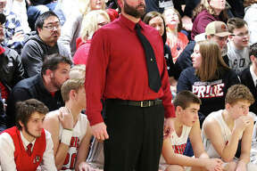 Calhoun coach Ryan Graner, watching his team compete during the Winchester Tournament, is 2020 Telegraph Small-Schools Boys Basketball Coach of the Year after leading the Warriors to a 25-8 record and a Class 1A regional title.