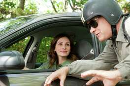 "Julia Roberts, left, and Tom Hanks are shown in a scene from ""Larry Crowne,"" which is currently streaming on Hulu."