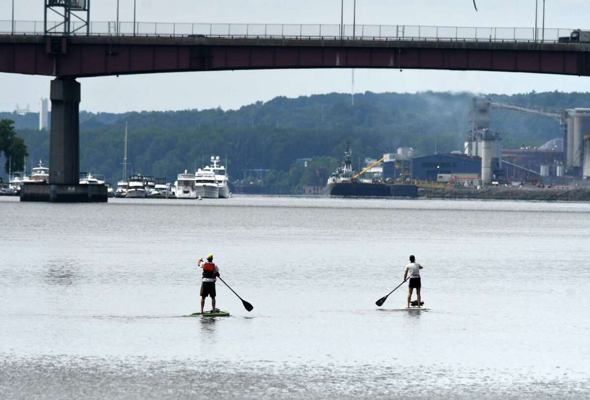 A pair of paddleboarders make their way down the Hudson River from the Corning Preserve boat launch on Friday, July 24, 2020, in Albany, N.Y. (Will Waldron/Times Union)