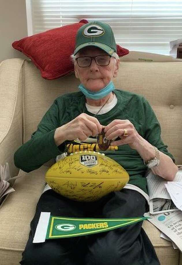 Duane Larsen with his haul of Green Bay Packers loot, including of course a hat. Photo: RVNA Health / Contributed Photo