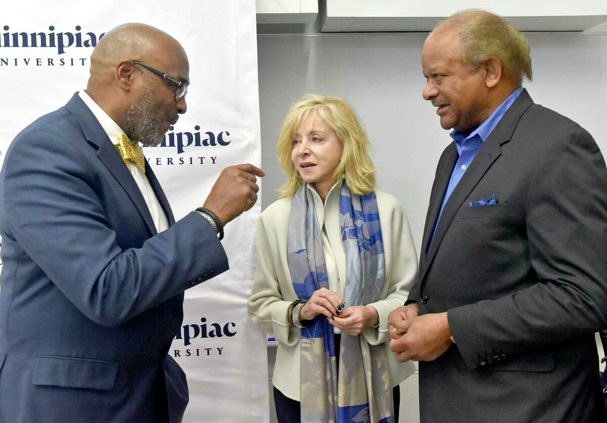 Fred McKinney, the Carlton Highsmith Chair of Innovation and Entrepreneurship and the Director of the People's United Center for Innovation and Entrepreneurship at Quinnipiac University, left, Quinnipiac University President Judy Olian, center, and Carlton Highsmith, vice chairman of the Quinnipiac University Board of Trustees.