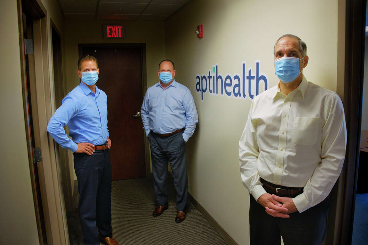 Carl Sgambati, M.D., left, chief medical officer for aptihealth, Dan Pickett, center, co-founder, president and CEO of aptihealth, and Alex Marsal, Ph.D., co-founder and chief clinical and science officer of aptihealth, pose for a photo at their office on Wednesday, July 22, 2020, in Troy, N.Y. (Paul Buckowski/Times Union)