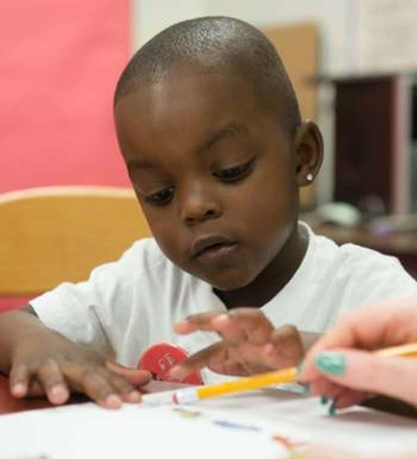 SIUE Head Start/Early Head Start children engage in learning during previous classroom sessions.