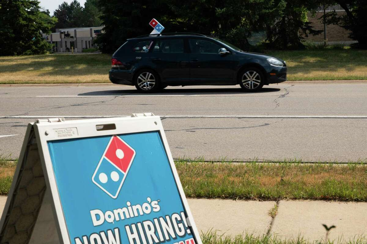 A Domino's Pizza Inc. driver delivers a customer's order in Southfield, Michigan, U.S., on Thursday, July 9, 2020. Domino's is scheduled to release earnings figures on July 16. Photographer: Emily Elconin/Bloomberg