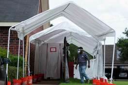 A tent and contaminated area is set up outside the Cambridge Health and Rehabilitation Center Thursday, July 23, 2020, in Richmond. A COVID-19 outbreak involving 22 nursing home residents and staff members has been reported in the facility. Texas Department of Emergency Management deployed the Texas Rapid Assessment Quick Reaction Force to the facility to conduct a site assessment and administer additional COVID-19 test to all nursing home residents, healthcare workers and staff members.