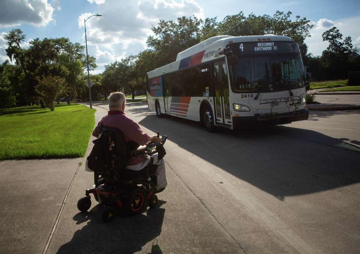 Lex Frieden waits to cross the street near his home in Houston on Thursday, July 23, 2020. Frieden was instrumental with his help in writing the American's with Disabilities Act. A paraplegic, he has been a major disability rights activist in Houston and beyond since his early twenties when he first became paralyzed from a car accident and worked with a group to get the city to install lifts onto their their buses.