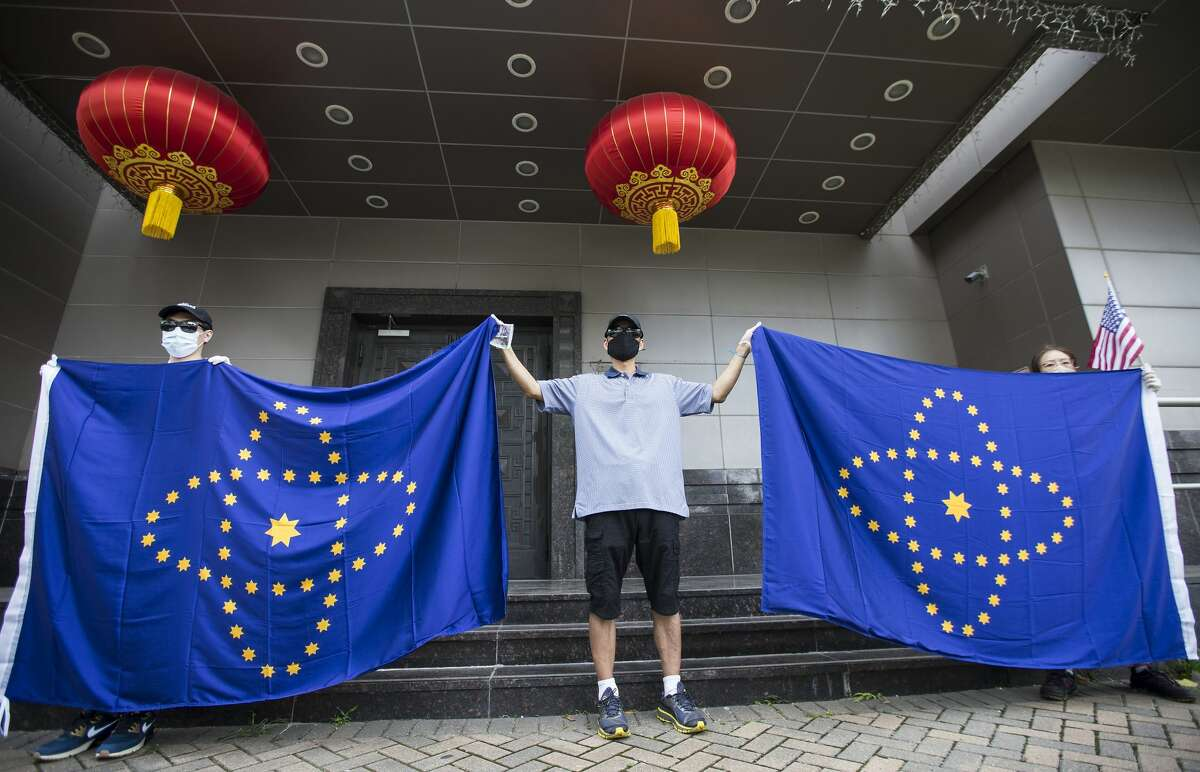 Demonstrators protest across the street from the Consulate General of China Friday, July 24, 2020, in Houston. U.S.government has ordered the Houston consulate to close by Friday.