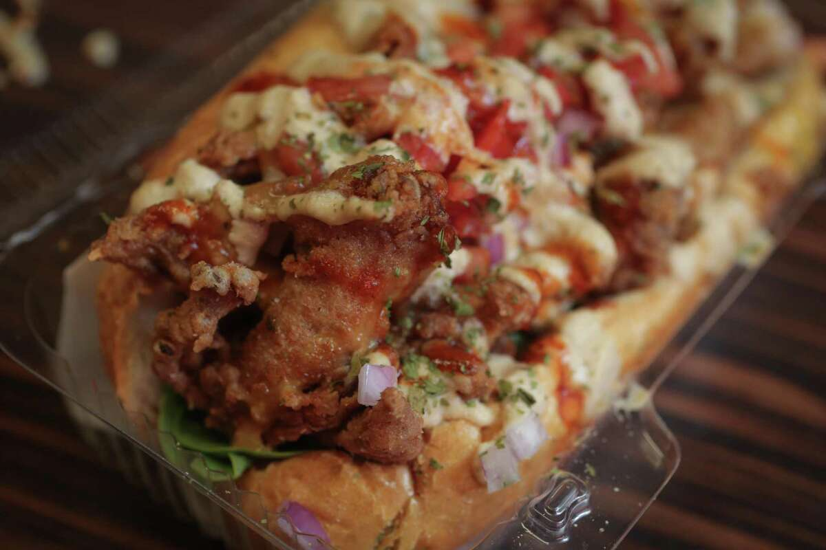 Soul Food Vegan's mushroom po'boy features fried oyster mushrooms on a gluten-free spelt-flour bun.