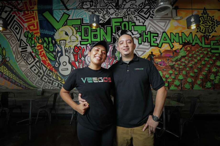 """Jesse and Denisse Hernandez, owners of Veegos Restaurant, stopped eating meat five years ago, then transitioned to veganism over the next couple years. Denisse remembers the couple's dog, who has since passed away, as one of the triggering points to going fully vegan. """"He was literally smarter than our kids at that point,"""" she recalled thinking after looking at him one day. Photo: Steve Gonzales, Houston Chronicle / Staff Photographer / © 2020 Houston Chronicle"""