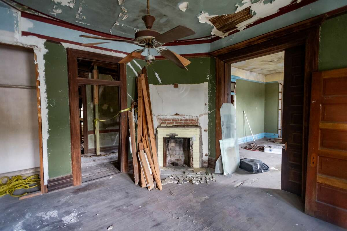 The former living room of the house with one of seven custom made fireplaces in the residence. The Caroline Gilbert Hinchee House in downtown Beaumont held a work day at the historic residence on Saturday, July 18, 2020 to continue work on the restoration. Photo made on July 18, 2020. Fran Ruchalski/The Enterprise
