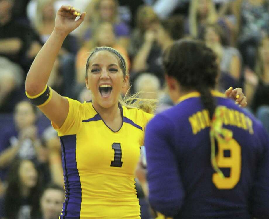 Caitlin Freie, formerly Ogletree, was The Courier's volleyball Player of the Year as a junior in 2009. Photo: Jerry Baker, Freelance / For The Chronicle / Freelance