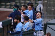 SEATTLE, WASHINGTON - JULY 19: Braden Bishop #5 (R) of the Seattle Mariners looks on from the dugout during a summer workout intrasquad game at T-Mobile Park on July 19, 2020 in Seattle, Washington. (Photo by Abbie Parr/Getty Images)