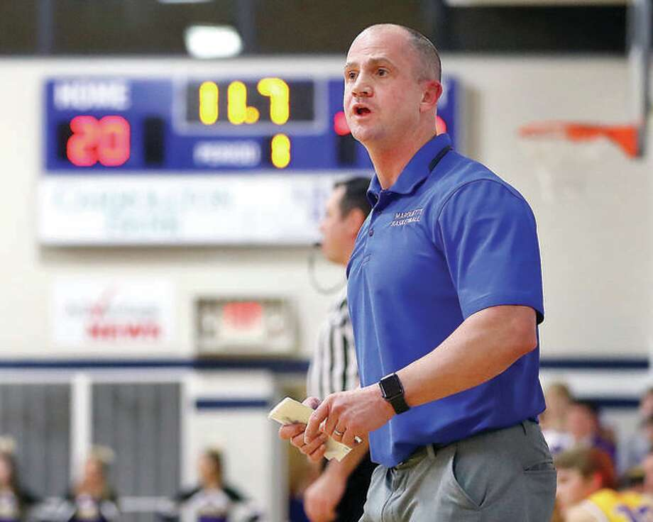 Marquette basketball coach Steve Medford watches the final seconds of a 2018 game. Medford said he's more in favor of not having a shot clock for high school basketball. He said not having a shot clock allows underdog teams to limit possessions by more athletic teams. Photo: Billy Hurst File Photo | For The Telegraph