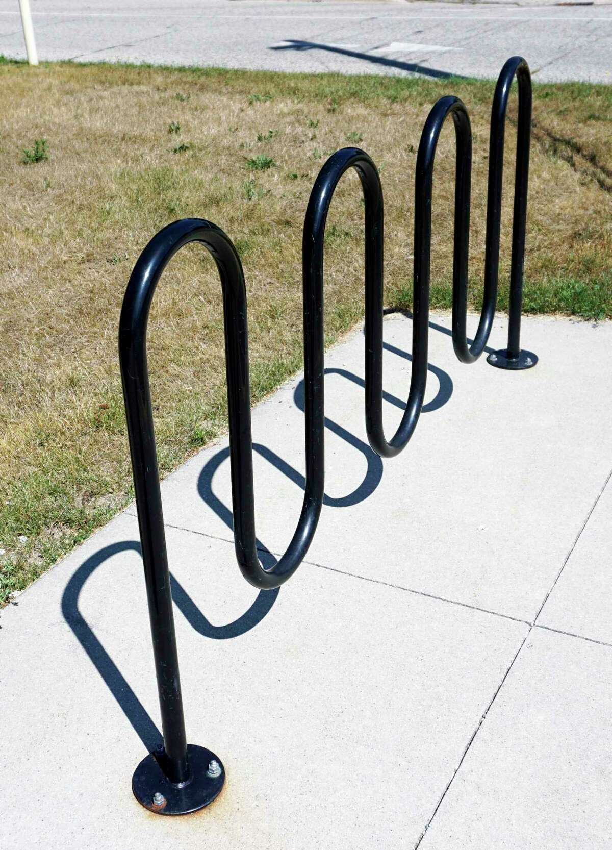"""According to the new section being added to article 5 of the zoning ordinance, bicycle parking will be required at all new parking lots. Parking shall consist of """"inverted U"""" or """"post and ring"""" style racks. (Pioneer photo/Joe Judd)"""