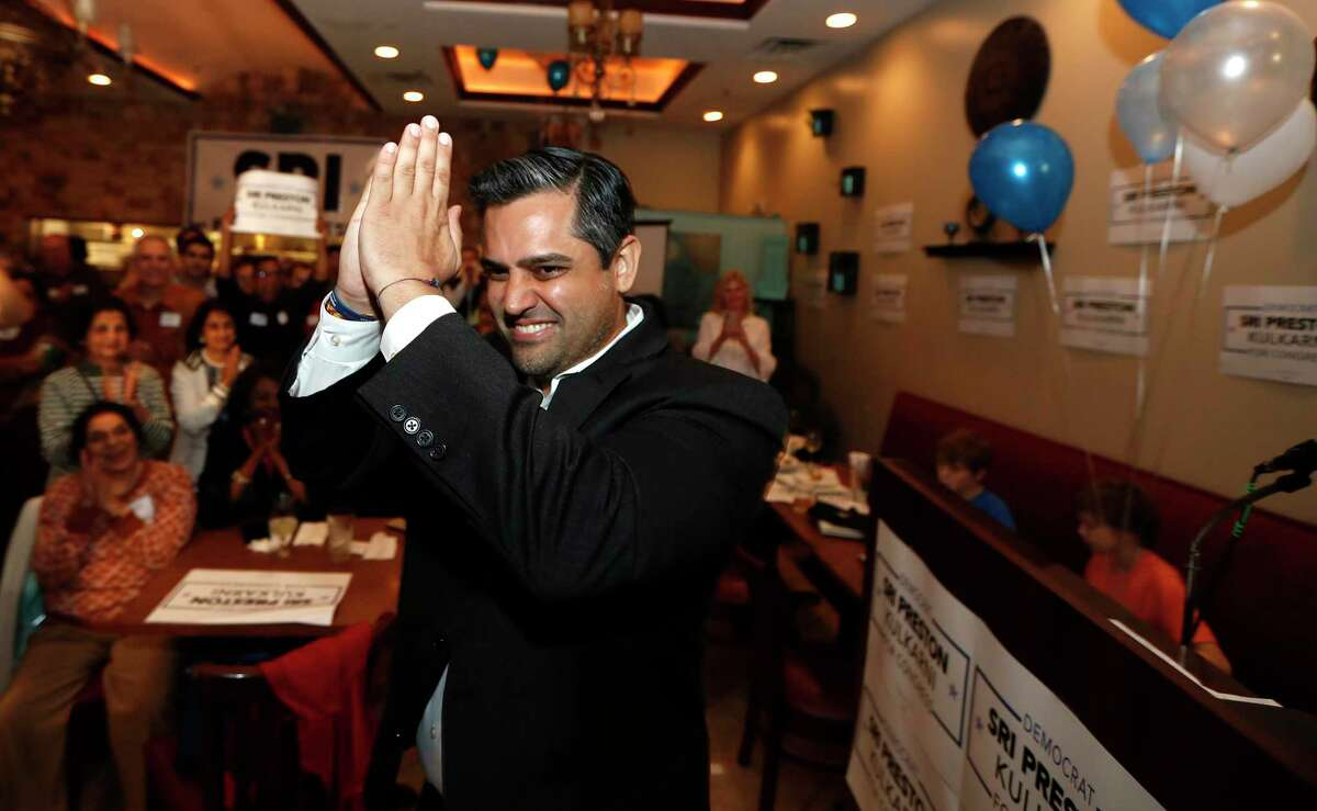 """Sri Kulkarni, the Democratic nominee in Texas' 22nd Congressional District, greets supporters with a """"namaste"""" at his watch party at Turquoise Grill & Bar in Sugar Land on Tuesday, March 3, 2020. Kulkarni accused his November opponent, Fort Bend County Sheriff Troy Nehls, of scrubbing his website of mentions of President Trump."""