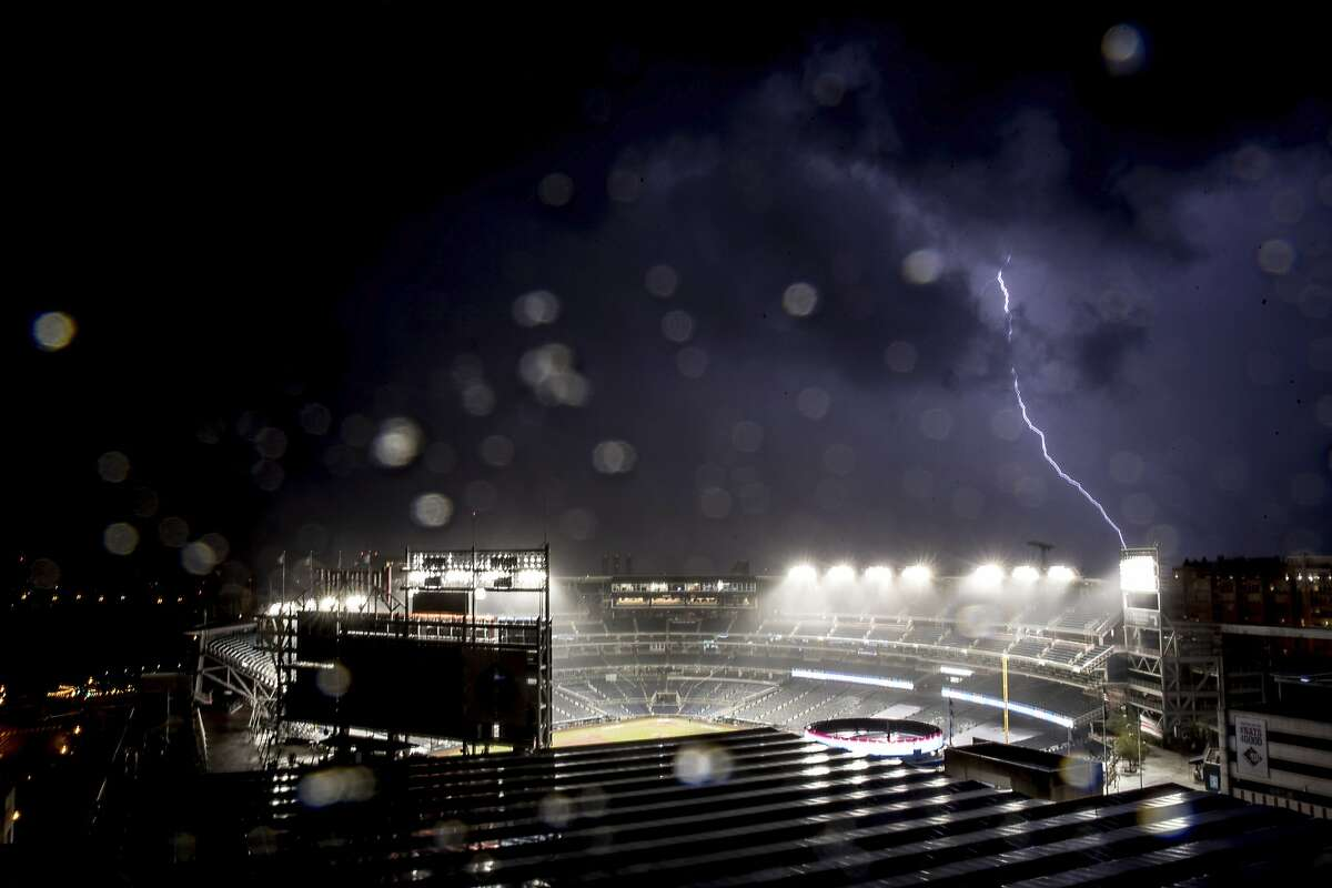 Rain and lighting halt an opening day baseball game between the New York Yankees and the Washington Nationals at Nationals Park, Thursday, July 23, 2020, in Washington. (AP Photo/Andrew Harnik)