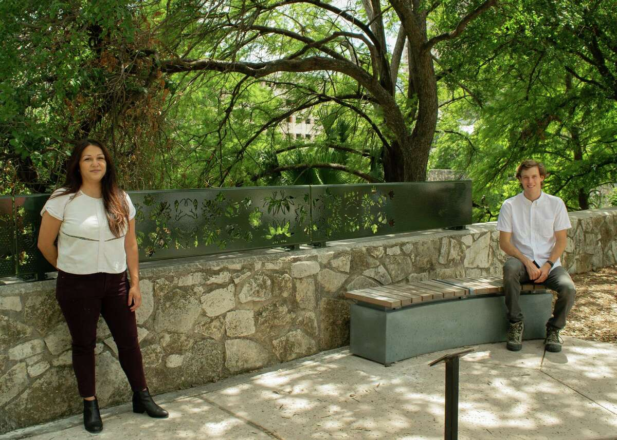 """Artists Ashley Mireles, from left, and Cade Bradshaw designed """"Green Spaces at Market Street,"""" metal railings on display at the River Walk Public Art Garden. The artists are using similar imagery for a pair of animal blinds they designed for the Robert L.B. Tobin Land Bridge currently under construction."""