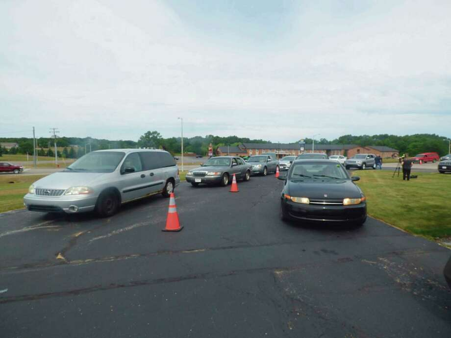 Dozens of vehicles lined up well before the start of a food pantry on July 14. The food pantry was sponsored by the Manistee Friendship Society and Feeding America West Michigan. (File photo)