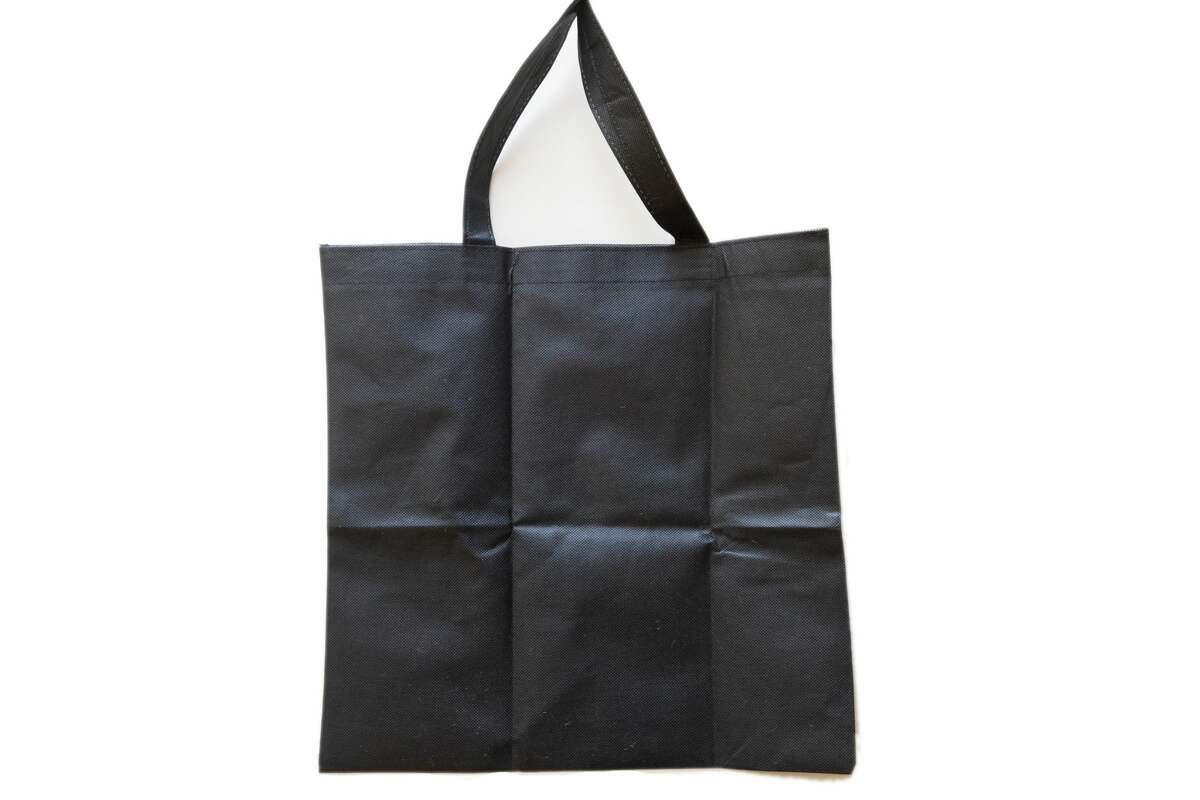 The material from a non-woven polypropylene (with a No. 5 recyclable label) reusable shopping bag can be used to make an effective face mask filter.
