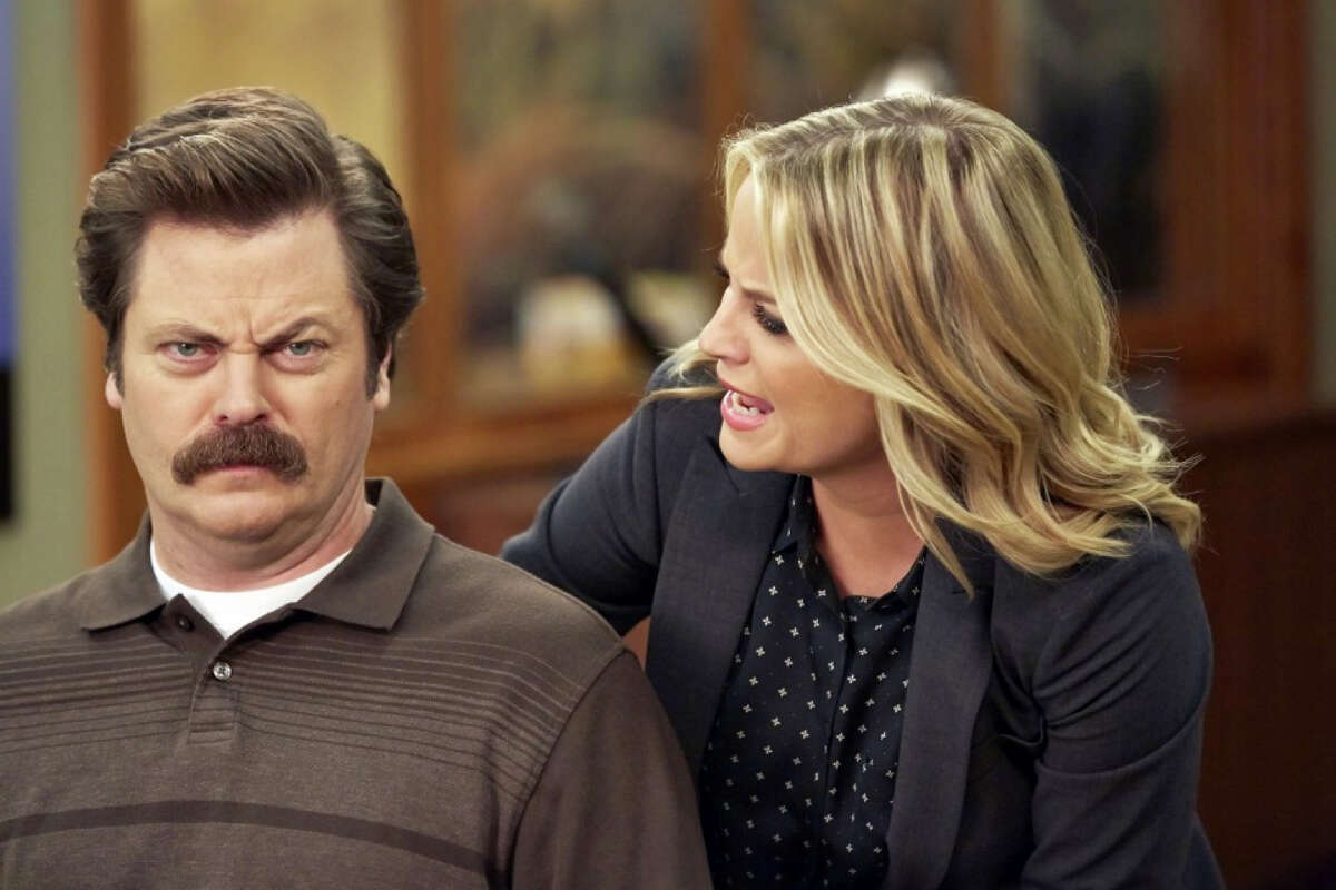 Nick Offerman as Ron Swanson and Amy Poehler as Leslie Knope in NBC's