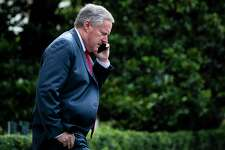 White House Chief of Staff Mark Meadows follows President Trump as he walks to board Marine One and depart from the South Lawn of the White House on Friday, July 10, 2020 in Washington.
