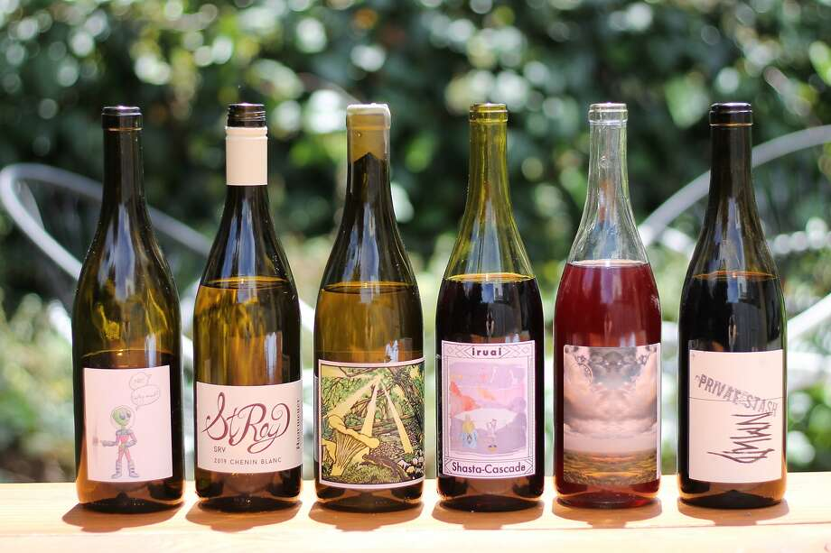 Some California natural wines to try, from left: Et Alia Picpoul Blanc, St. Rey Chenin Blanc, Florèz Chardonnay, Iruai Shasta-Cascade Red, Woods Zinfandel and Absentee NMWD. Photo: Esther Mobley / The Chronicle