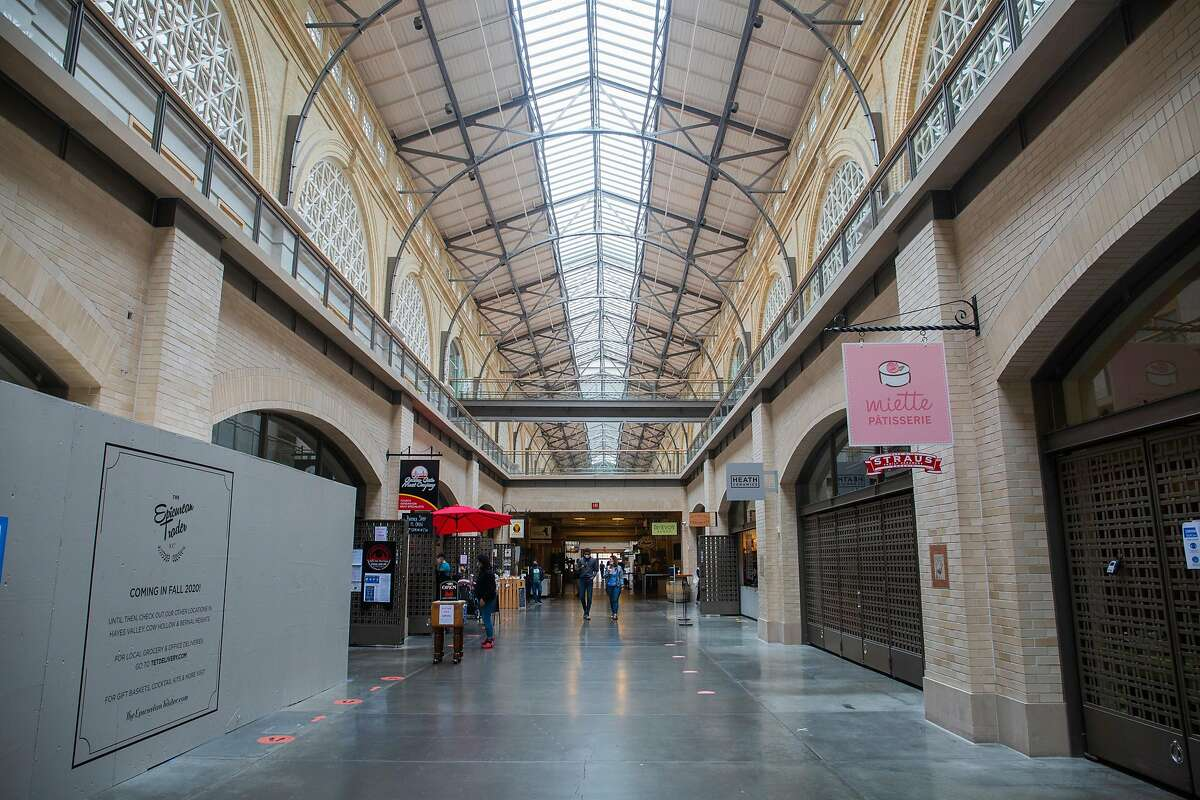 The Ferry Building in San Francisco was forced to close down on Wednesday and has reopened with stricter health protocol on Friday July 24, 2020. Social distancing reminders and mask protocol signs line the building's inside.