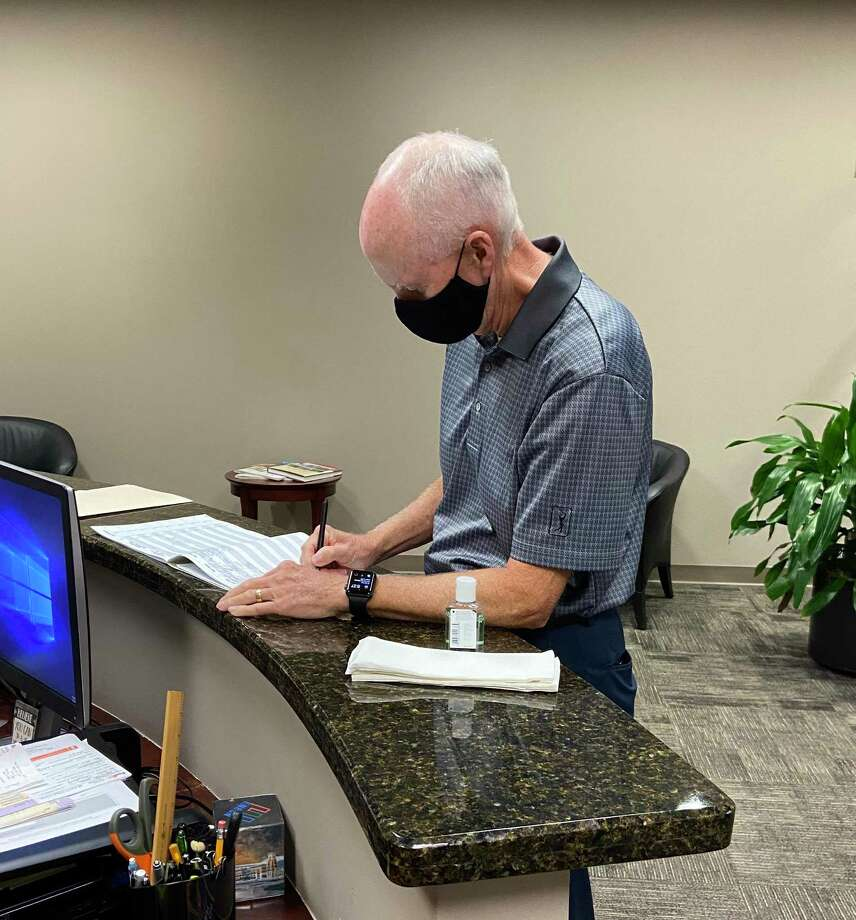 Jim Cain completes application for a place on the ballot for the November 3 Election of the Lone Star College System Board of Trustees - District 9 in the Chancellor's Office. Photo: Jim Cain