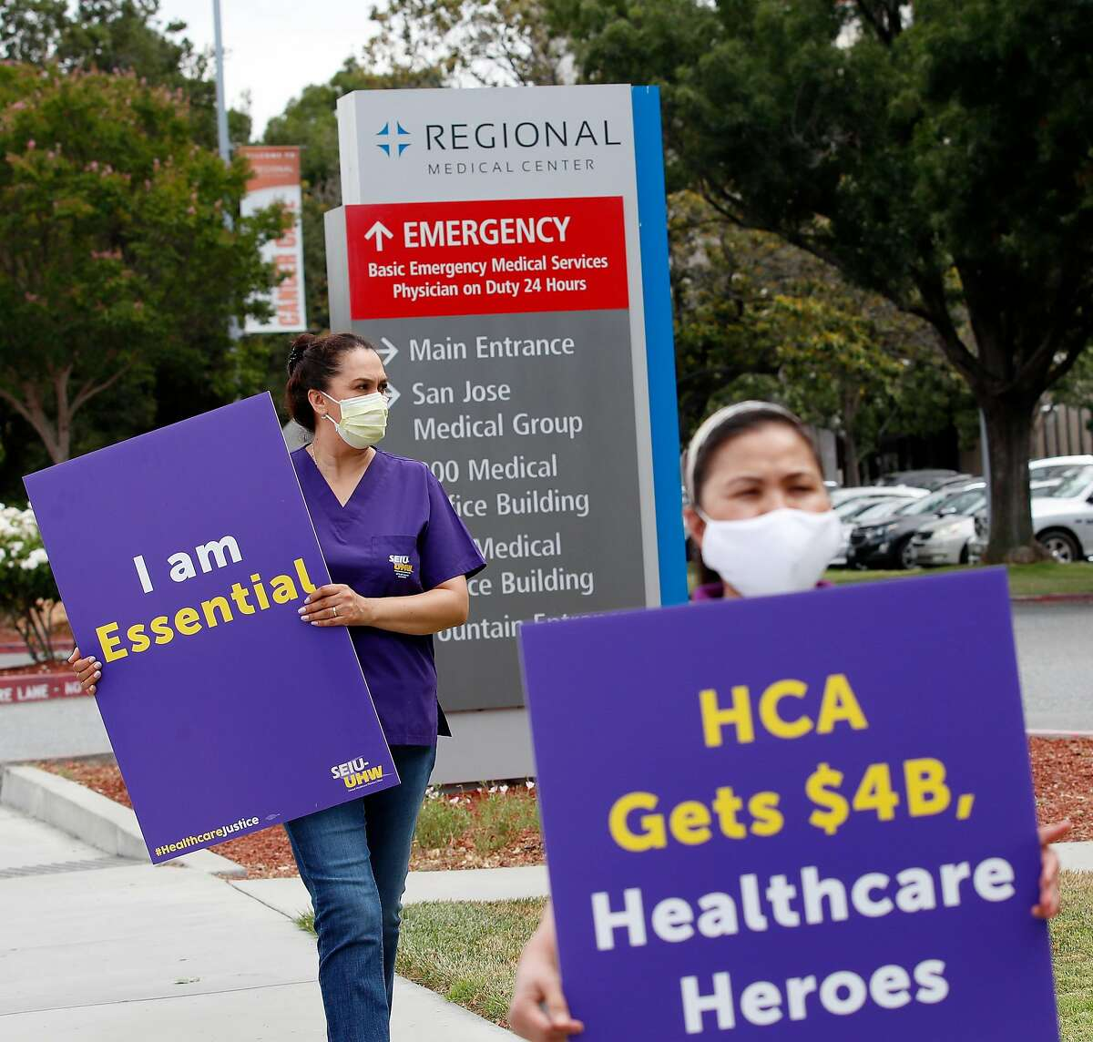 (Left-right) Healthcare workers, Maria Casorla and Cecilia Gidley, participate in rally to protest the hospitals' cut to caregivers' retirement benefits as workers continue to risk their lives to care for patients during the COVID-19 pandemic. At Regional Medical Center, in San Jose, California on Tuesday, July 21, 2020. Staffing shortages haven't reached crisis levels just yet. But if current trends continue, the conditions for shortfalls loom large.